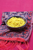 Indian cuisine. Bowl of boiled rice on red background — Stock Photo