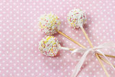 White cake pops on pink dotted background — Stock Photo
