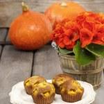 Pumpkin muffins on wooden table in autumn setting. Halloween — Stock Photo #38940143