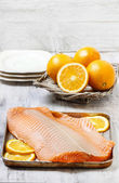 Big raw salmon fillet on wooden table — Stock Photo