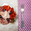 Delicious sliced ham. Party platter of assorted cured meats — Stock Photo #39073059