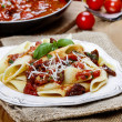 Penne with dried tomatoes. Italian cuisine, delicious — Stock Photo #39074547