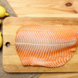 Big raw salmon fillet on wooden tray — Stock Photo