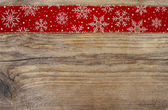 Golden christmas stars on red fabric. Wooden blank board for you — Stock Photo