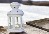 Beautiful white lantern at the wooden pier. Wide river — Stock Photo