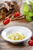 Bowl of macaroni on wooden table. Fresh vegetables and pickled — Stock Photo