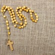 Rosary on jute background. Copy space — Stock Photo #39212995