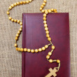 Holy Bible and rosary on jute background. Copy space — Stock Photo #39213049