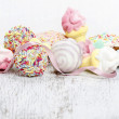 Confectionery on white wooden table, white background — Stock Photo #39214187
