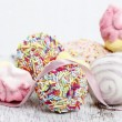 Confectionery on white wooden table, white background — Stock Photo #39214217