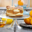 Piece of toffee and vanilla cake on transparent glass cake stand — Stock Photo #39218567