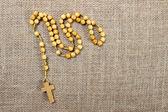 Rosary on jute background. Copy space — Stock Photo