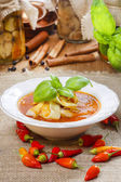 Tomato and pepper soup in white plate. — Stock Photo