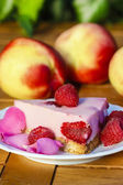Piece of raspberry cake decorated with fresh fruits and rose — Stock Photo