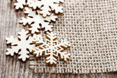 Wooden stars on jute background. Copy space for your text — Foto de Stock