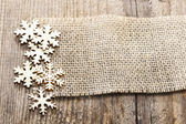 Wooden stars on jute background. Copy space for your text — Stock Photo