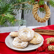 Delightful traditional christmas cookies under fir branch — Stock Photo #40112451