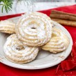Delightful traditional christmas cookies under fir branch — Stock Photo #40112551