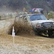 Cars taking part in annual off road racing at Kryspinow lake — Stock Photo #40112641