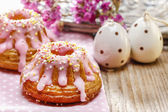 Traditional easter yeast cake covered with pink icing and color — Stock Photo