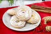 Delightful traditional christmas cookies under fir branch — Stock Photo