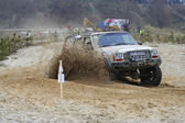 Cars taking part in annual off road racing at Kryspinow lake — Stock Photo
