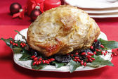 Baked pork with dried plums on christmas table — Stock Photo