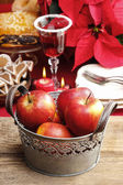 Silver bucket of red christmas apples. Poinsettia flower — Stockfoto