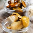 Pickled mushrooms in transparent glass bowl — Stock Photo #40988955