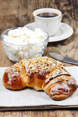 Healthy breakfast: french croissant with nuts and bowl of cottag — Stock Photo