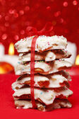 Stack of gingerbread cookies in star shape on red background — Stock Photo
