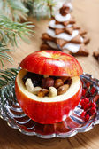 Red christmas apples stuffed with dried fruits in honey — Stock Photo