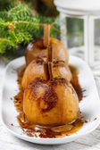 Caramel apples on white wooden table. Christmas tree in the back — Stock Photo