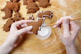 Decorating gingerbread cookies for christmas. Steps of making bi — Stock Photo