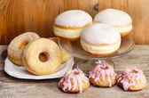 Donuts and easter cakes on wooden table. — Stock Photo