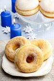 Donuts with jam on party table — Stockfoto