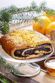 Poppy seed cake on glass cake stand under fir branch. Christmas — Stock Photo