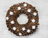 Christmas wreath made of brown cones — Stock Photo
