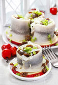 Pickled herring rolls with vegetables — Stock Photo