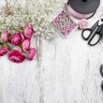 Florist at work. Woman making beautiful bouquet of pink persian — Stock Photo #47582663