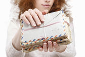 Woman holding package of vintage letters — Stock Photo