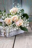 Beautiful pink roses and gypsophila paniculata (Baby's-breath fl — Stock Photo