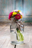Bouquet of wild flowers in glass vase — Stock Photo