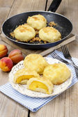Peach in pastry, popular austrian dish. Garden party table — Stock Photo