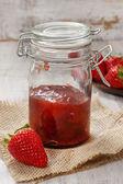 Strawberry jam in preserving glass — Stock Photo