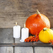 Halloween party decor. Beautiful orange pumpkins on wooden table — Stock Photo #47941841