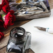 Writing a letter. White sheet of paper, ink and red carnation fl — Stock Photo #47942077