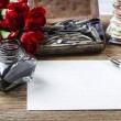 Writing a letter. White sheet of paper, ink and red carnation fl — Stock Photo #47942435
