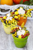 Candle holder decorated with autumn flowers and other plants. Se — Stock Photo