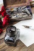 Writing a letter. White sheet of paper, ink and red carnation fl — Stock Photo